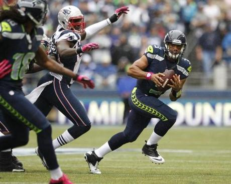 Seattle Seahawks quarterback Russell Wilson scrambled with the ball in the first half.